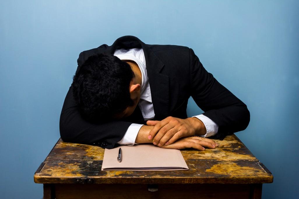 bigstock-businessman-sleeping-after-clo-55764650-e1408666353326